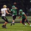 HALEY WARD | THE GOSHEN NEWS <br /> Concord quarterback Jack Lietzan passes the ball while Concord running back Dominick De Broka blocks Wawasee linebacker Paul Mendoza Friday at Concord High School.