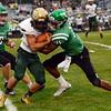 HALEY WARD | THE GOSHEN NEWS <br /> Concord defensive back Cedric Mitchell tackles Wawasee running back Noah Wadkins Friday at Concord High School.