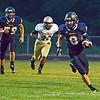HALEY WARD | THE GOSHEN NEWS <br /> Fairfield quarterback Brady Willard carries the ball during the game against Niles Friday at Fairfield Junior-Senior High School.
