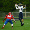 HALEY WARD | THE GOSHEN NEWS<br /> Fairfield sophomore Cordell Hofer catches the ball as West Noble junior Spencer Shrock looks to make the tackle Friday at West Noble High School.