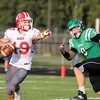 CHAD WEAVER | THE GOSHEN NEWS<br /> Goshen quarterback Charlie Collins directs a receiver as Concord linebacker Dawson Demien applies some pressure during the first quarter of Friday night's game at Concord.