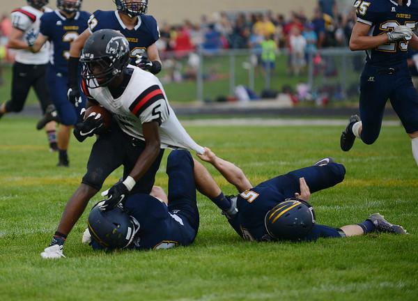 HALEY WARD   THE GOSHEN NEWS<br /> NorthWood wide receiver DeAndre Smart is brought down by Fairfield safties Brady Willard and Sylvanus Miller Friday at Fairfield Junior-Senior High School.