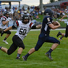 HALEY WARD | THE GOSHEN NEWS<br /> NorthWood linebacker Braden Mikel attempts to tackle wide receiver Sylvanus Miller Friday at Fairfield Junior-Senior High School.