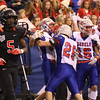JAY YOUNG   THE GOSHEN NEWS <br /> NorthWood junior DeAndre Smart (5) walks to the sidelines as Indianapolis Roncalli players celebrate a touchdown during the 4A state championship game Friday afternoon at Lucas Oil Stadium in Indianapolis.