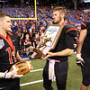 JAY YOUNG   THE GOSHEN NEWS <br /> NorthWood captains Drew Minnich (11), Trey Bilinski, middle, and Caleb Newcomer (62) stand withtthe runner up trophy following the 4A state championship game Friday afternoon at Lucas Oil Stadium in Indianapolis.