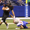JAY YOUNG   THE GOSHEN NEWS <br /> NorthWood junior Payton Bear (34) slips a tackle attempt by Indianapolis Roncalli's Gabe Otley (15) during the 4A state championship game Friday afternoon at Lucas Oil Stadium in Indianapolis.
