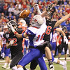 JAY YOUNG   THE GOSHEN NEWS <br /> NorthWood junior Brayton Yoder, right, breaks up a pass intended for Indianapolis Roncalli's Jacob Luedeman (16) during the 4A state championship game Friday afternoon at Lucas Oil Stadium in Indianapolis.