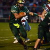 HALEY WARD   THE GOSHEN NEWS<br /> Wawasee quarterback Tyler Smith carries the ball against NorthWood Friday at Wawasee High School.