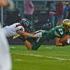 HALEY WARD   THE GOSHEN NEWS<br /> NorthWood defensive back Landon Gessinger tackles Wawasee wide receiver Jacob Hand as he makes the diving catch Friday at Wawasee High School.