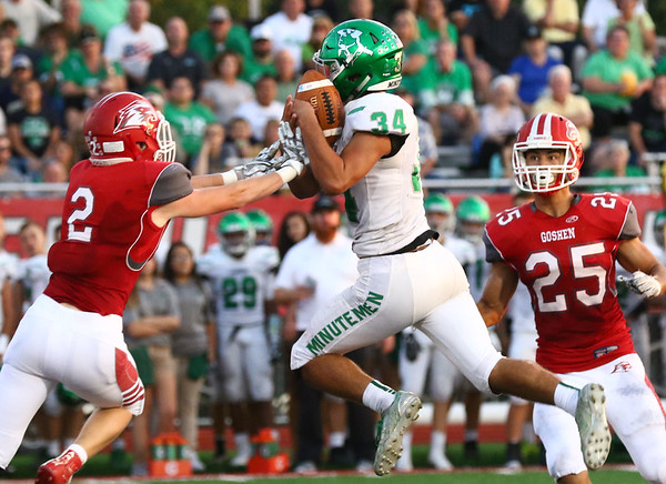 JAY YOUNG | THE GOSHEN NEWS<br /> Goshen High School senior defensive back Preston Hershberger (2) breaks up a pass intended for Concord High School senior Dominick De Broka (34) during their game Friday night at GHS.