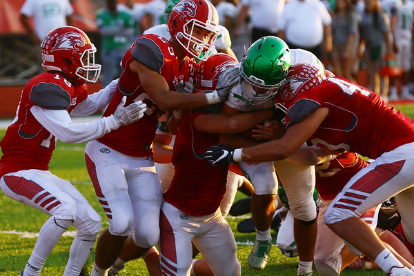 JAY YOUNG | THE GOSHEN NEWS<br /> Concord High School senior running back Jack Lietzan drags a pack of Goshen High School defenders with him as he scores a touchdown during their game Friday night at GHS.