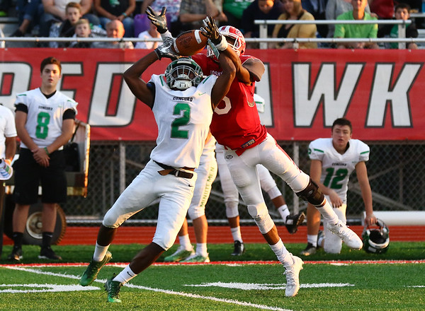 JAY YOUNG | THE GOSHEN NEWS<br /> Goshen High School junior receiver Daveyon Sandford (6) reaches over Concord High School junior defensive back Jakale Conerly (2) to pull down a reception during their game Friday night at GHS.