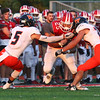 JAY YOUNG | THE GOSHEN NEWS<br /> Goshen High School senior Brandon Holley (25) is quickly brought down by a pair of Warsaw High School defenders during their game Friday night at GHS.