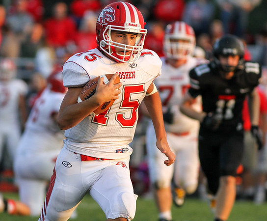 CHAD WEAVER | THE GOSHEN NEWS<br /> Goshen quarterback Wesley VanHoosier breaks free for a long run during the second quarter of Friday night's game at NorthWood.