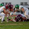 Sam Householder | The Goshen News<br /> Concord defenders Zaven Koltookian (35) and Corbin Hartpence (58) tackle Mishakwaka running back Andrew Mason during the game Friday.