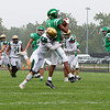 Concord Minutemen wide receiver Armarion Moore (1) completes a pass against Wawasee Warriors defensive back Lucas Ringler (6) Saturday during the game at Concord High School in Elkhart.