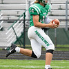 Concord Minutemen quarterback Tommy Kinsman (14) rushes the ball for a touchdown Saturday during the game at Concord High School in Elkhart.