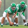 Concord Minutemen offensive linemen Griffin Swartout (51) snaps the ball Saturday during the game at Concord High School in Elkhart.