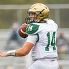 Wawasee Warriors quarterback Parker Young (14) drops back to pass the ball to his teammate Saturday during the game at Concord High School in Elkhart.