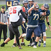 Fairfield Falcons defensive linemen Jason Massaro (77) attempts to block Fremont Eagles kicker Logan Brace (26)  Friday during the game at Fairfield Jr.-Sr. High School.