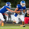 West Noble Chargers Derek Slone (2) hands off the ball to his teammate Kolby Knox (15) during the game Friday at West Noble High School in Ligonier.