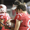 Goshen head coach Kyle Park goes over a play with senior quarterback Colin Turner (9) during Friday night's game with Lafayette Harrison.