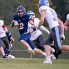 Fairfield Falcons halfback Dalton Cripe (22) advances the ball for positive yards during Friday's game at Fairfield High School Jr./Sr. High School in Goshen.