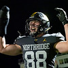 Northridge Raiders senior Carter Bach (88) reacts after a play during Friday's game at Northridge High School in Middlebury.