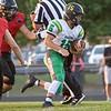 Northridge Raiders quarterback Logan Hooley (15) runs for positive yards during the game at NorthWood High School in Nappanee.