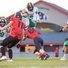 Northridge Raiders wide receiver Mason Puckett (2) hurdles over NorthWood Panthers defensive linemen Darren Chapman (68) during the game at NorthWood High School in Nappanee.