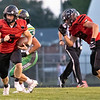 NorthWood Panthers quarterback Nate Newcomer (5) runs the ball on a quarterback keeper during the game at NorthWood High School in Nappanee.