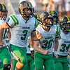 Northridge Raiders running back Andrew Lockwood (3) leads his teammates out on the field Friday before the game at NorthWood High School in Nappanee.