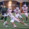 Goshen junior Mitch Daniels (32) tackles Wawasee junior Nathan Larson (20) Friday night as the RedHawks visited the Warriors in Syracuse.