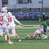 Goshen sophomore Noah Alford (10) tackles Wawasee senior Parker Young (14) during the first half of Friday night's game in Syracuse.