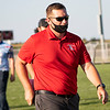 Lakeland Lakers head coach Ryan O'Shea walks off the field before the game between the Wawasee Warriors and the Lakeland Lakers Friday at Lakeland High School.