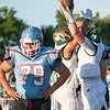 Lakeland Lakers defensive lineman Alex Pelham (79) reacts after Wawasee Warriors Kameron Salazar (11) scores a touchdown with his teammate Parker Young (14) during the game between the Wawasee Warriors and the Lakeland Lakers Friday at Lakeland High School.
