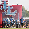 Lakeland Lakers quarterback Deion Marshall (9) leads his teammates out on the field to start the game between the Wawasee Warriors and the Lakeland Lakers Friday at Lakeland High School.