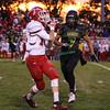 CHAD WEAVER | THE GOSHEN NEWS<br /> Goshen wide receiver Brady Bechtel catches a pass in front of Northridge defensive back Kurtis Hochstetler during the first quarter of Friday night's game at Northridge.