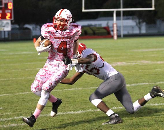 SAM HOUSEHOLDER | THE GOSHEN NEWS<br /> GOshen junior Rummel Johnson pushes Plymouth senior Cam Eveland during the game Friday at Plymouth High School.