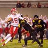 SAM HOUSEHOLDER | THE GOSHEN NEWS<br /> Goshen quarterback C.J. Detweiler jukes a Snider defender during the sectional game Friday.