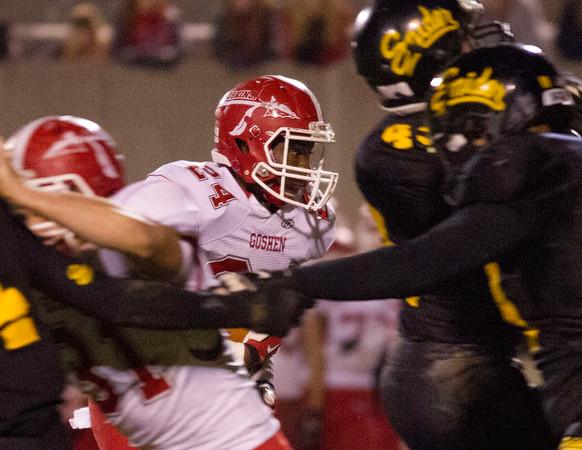 SAM HOUSEHOLDER | THE GOSHEN NEWS<br /> GOshen junior Jeff Stoll runs with the football during the game Friday against Fort Wayne Snider Friday.