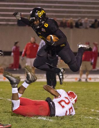 SAM HOUSEHOLDER   THE GOSHEN NEWS<br /> Snider running back Dominick Scott tries to leap over the tackle of Goshen junior Rummel Johnson during the game.