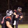 SAM HOUSEHOLDER | THE GOSHEN NEWS<br /> NorthWood junior quarterback Trey Bilinski throws a pass to teammate senior Bailey Gessinger during the game against East Noble Friday.