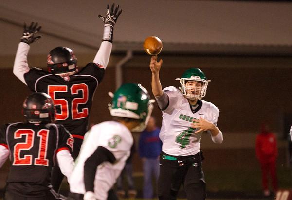SAM HOUSEHOLDER   THE GOSHEN NEWS<br /> Concord senior quarterback Jason Grooms passes the ball to senior teammate Luke Simon during the sectional game at Fort Wayne Northside Friday.
