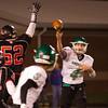 SAM HOUSEHOLDER | THE GOSHEN NEWS<br /> Concord senior quarterback Jason Grooms passes the ball to senior teammate Luke Simon during the sectional game at Fort Wayne Northside Friday.