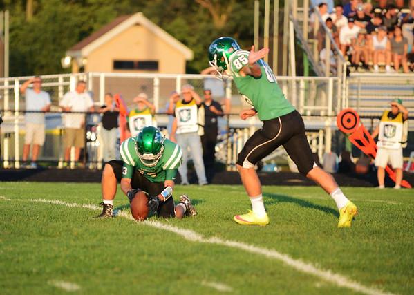 HALEY WARD | THE GOSHEN NEWS <br /> Concord kicker Josh Gorbal kicks a field goal as Jocco Iavagnilio holds the ball during the game against Saint Joseph Friday at Concord High School.