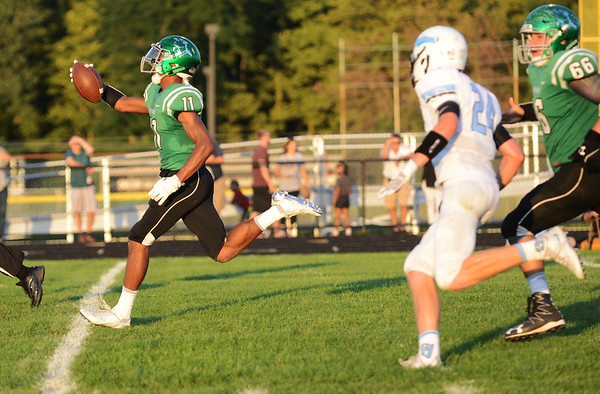 HALEY WARD | THE GOSHEN NEWS <br /> Concord wide receiver Cedric Mitchell runs the ball in for a touchdown in the game against Saint Joseph Friday at Concord High School.