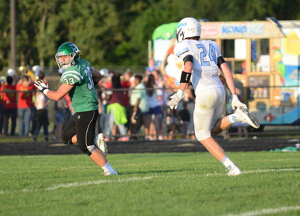 HALEY WARD | THE GOSHEN NEWS <br /> Concord running back Ryan Cook runs down the field to score against Saint Joseph Friday at Concord High School.