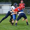 HALEY WARD | THE GOSHEN NEWS<br /> Fairfield seniors Lucas Niswonger and Sylvanus Miller tackle West Noble senior Sebastian Loy Friday at West Noble High School.