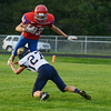 HALEY WARD | THE GOSHEN NEWS<br /> Fairfield junior Triston Ritter attempts to tackle West Noble freshman Joss Gross during a punt return Friday at West Noble High School.